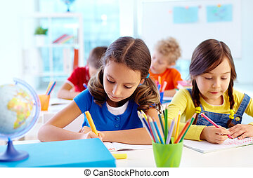 Concentrated pupils - Concentrated school children being ...