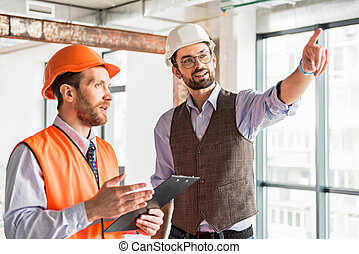 Attentive Repairman Checking Appliance Concentrated Man