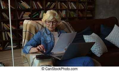 Concentrated senior woman making her financial planning -...