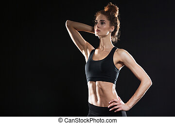 Concentrated serious young sports lady - Image of...