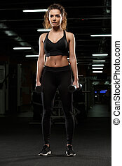 Concentrated strong sports lady make sport exercises