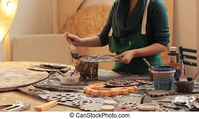 Concentrated woman coloring pieces - Young woman in apron...