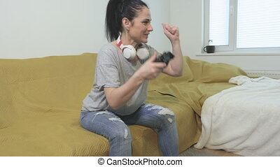 Concentrated woman playing video games and winning