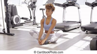 Concentrated woman practicing yoga - Young ethnic girl in...