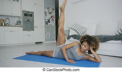 Concentrated woman training at home