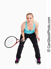 Concentrated woman waiting a tennis ball