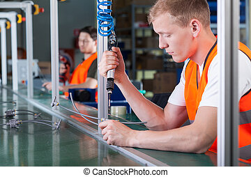 Concentrated workers on production line - Concentrated young...
