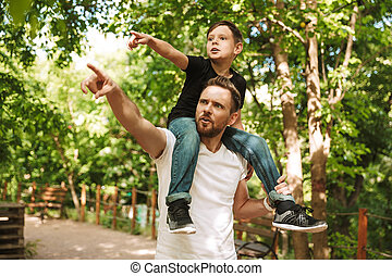 Concentrated young father have fun with his little son
