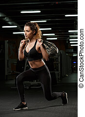 Concentrated young strong sports lady make sport exercises