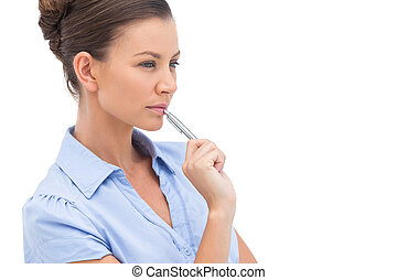 Concentrating businesswoman with pen