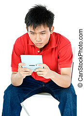 Concentrating hard - teen playing a game