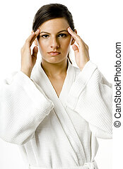 Concentration - A young woman with eyes open and hands ...