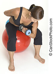 Concentration Curl 4 - A female fitness instructor ...