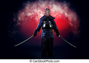 concentration - Handsome young man practicing kendo. Over ...