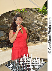 Concentration - Lady concentrating on her chess game