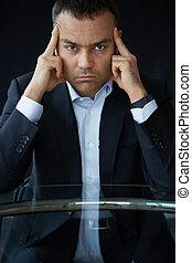 Concentration - Portrait of elegant businessman touching his...
