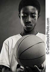 concentration - Teenage boy looking the basketball