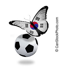 Concept - butterfly with South Korea flag flying near the ball, like football team playing