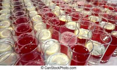 Concept catering. Many glasses with juice and lemonade are on the table at the gala event. The camera slides along the glasses.