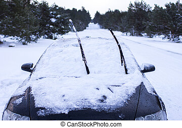concept - close-up of a car in the snow