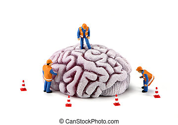 Concept: Construction workers inspecting brain - Concept...