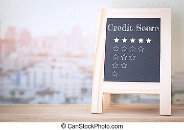 Concept CREDIT SCORE message on wood boards
