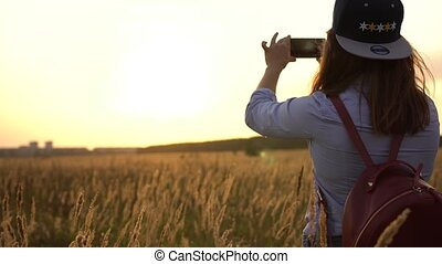 Young Unidentified Woman Shoots Beautiful Nature - Concept...