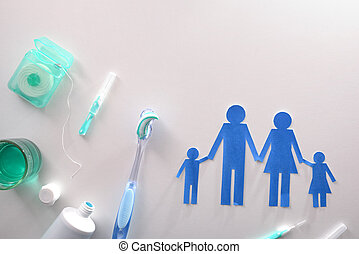 Concept family dental hygiene with tools on white table