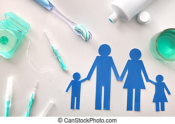 Concept family dental hygiene with tools on white table...