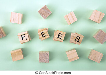 Fees - Concept Fees: Wooden cubes with the letters Fees on...