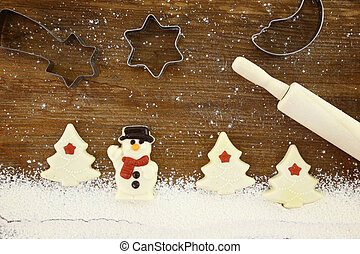 Concept for baking with flour and cookies, wooden background