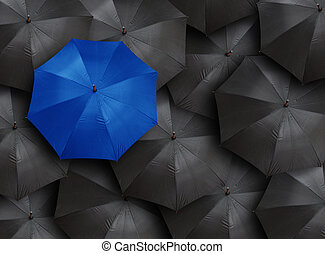 umbrella - concept for leadership with many blacks and blue ...