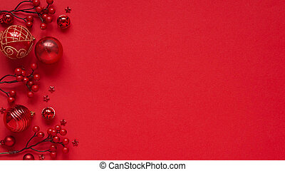 Concept for New Year and Christmas banner.Christmas decor, red balls, berries and stars on a red background, top view, flat lay, copy space.Christmas card with place for text, lettering.