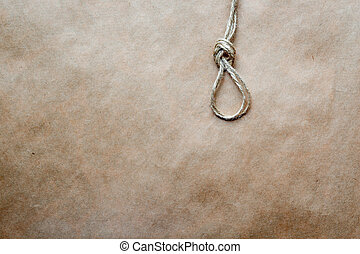 concept hangman's knot on kraft paper background