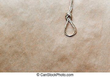 concept hangman's knot on kraft paper background soft light