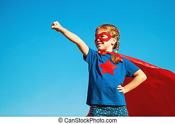 concept happy child superhero hero in red cloak in nature - ...