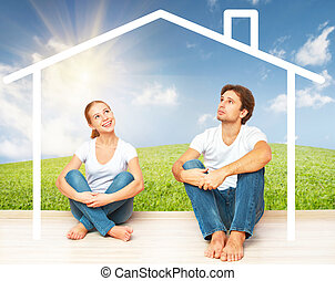 Concept:  housing and mortgage for young families. couple dreaming of  home