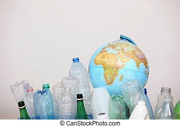 Concept image illustrating recycling plastic bottles to protect the planet
