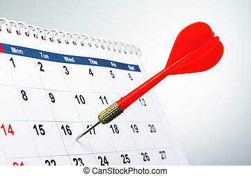 Concept image of fixing a schedule. - Sticking arrow into...