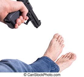Man shooting himself in the foot