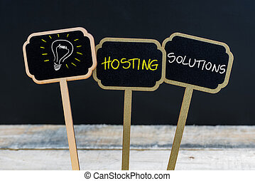 Concept message HOSTING SOLUTIONS and light bulb as symbol for idea