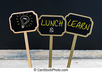 Concept message LUNCH and LEARN and light bulb as symbol for idea