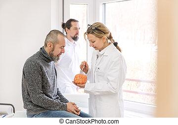 concept neurologist - female neurologist is showing a male...