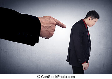 Concept of accused businessman with with fingers pointing