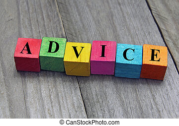 concept of advice word on wooden cubes
