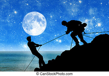 Silhouette of two climbers