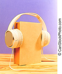 Books on the table with headphones put on them