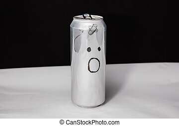 Concept of beaten man with plaster strip. Astonished emoticon on aluminium can, Emoji with surprised face. On black background