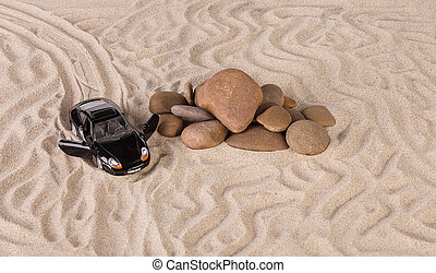 Concept of black racing car on the sand.