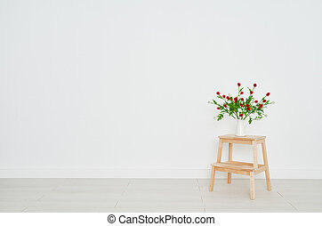 concept of bouquet of flowers on stepladder on background white brick wall in an empty room